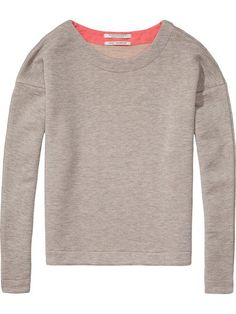 This Maison Scotch grey marl sweatshirt has a perfect pop of colour. 70% cotton, 30% polyester Wash at 30º best not to tumble dry.