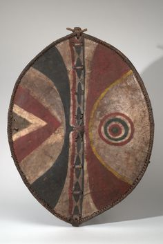 MAASAI Country: KENYA Material: HIDE, WOOD, PIGMENT, COATING Dimensions: L:96.5 W:69 [in CM] Acquisition Year: 1953