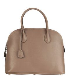 This luxe leather handbag, expertly crafted in Italy, comes equipped with a surplus of splendid interior secrets to help keep things organized including a zip pocket and a cell phone pouch. A zip closure holds items securely inside. Carting around daily necessities is easy with the removable shoulder strap for hands-free convenience.