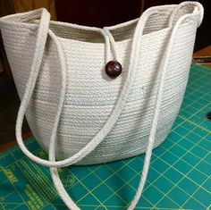 Rope Tote: coiled cotton & sewn in sage green zig-zag stitch. Upcycled button. By Andrea