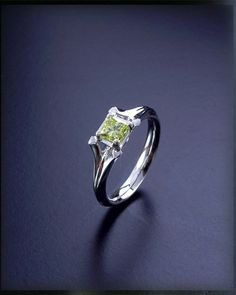 This engagement ring is from the reflections range and is set with a yellow diamond.