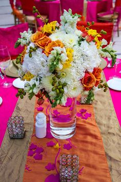 Bright colors can be accented with gorgeous flowers #SecretsSilversandsRivieraCancun #Mexico #DestinationWedding