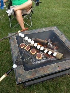 Someone is clearly a genius. Using a rake to make s'mores.