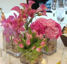 This is a selection of cube vase floral arrangements featuring pink tulips, mokara orchids, peonies and  miniature calla lilies.  See our entire selection at www.starflor.com.  To purchase any of our floral selections, as gifts or décor, please call us at 800.520.8999 or visit our e-commerce portal at www.Starbrightnyc.com. This composition of flowers is generally available for same day delivery in New York City (NYC). SQ153