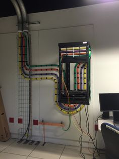 Beautiful KVM cabling into a rack. Colorful, yellow, orange, purple, and green
