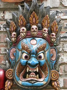 Mahakala is meant to scare bad spirits and energy away from the place it protects. ..his aggression directed at those who would do harm. His face is frightening also to scare away negative thoughts, actions, and energy. The power of his fiery demeanor exists to guide spiritual seekers who are falling victim to deception, delusion, or who are lacking confidence in their abilities to change, grow, or find their most positive place in the world.
