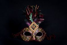 Women's masquerade or mardi gras mask. Silk with high burgundy, gold and green colours. www.warriormask.com ships from Canada