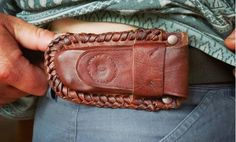Ethical and traditionally tanned leather belt pouch for multi-tool/ pocketknife made from bark tanned goat skin. Having the pouch sideways stops it from digging into your thigh!