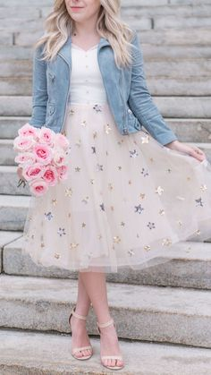 Sparkly star print dress with blue cropped moto jacket.
