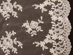 "Nice - Bridal Lace- Style #91436W. 52"" Wide. 100% Polyester. Priced per 5 yard piece. Allover embroidered and corded Schiffli Lace with a Single Scalloped Edge."