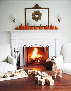 pumkins, white and wooden toys...love how it all looks!!!