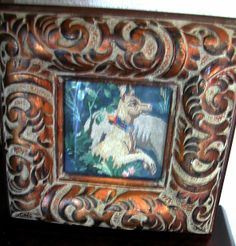 Framed gobelin dog - like the heavy frames - good idea for the small tapestry pieces
