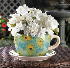 Strut your green thumb and show off your favorite potted plant in this charming teacup planter. Royal turquoise and vivid peacock feathers on both the cup and saucer will make your favorite blooms look even more fantastic. Drain hole at bottom of teacup. Teacup Plants, Teacup Flowers, Flower Pots, Bulb Flowers, Large Planters, Planter Pots, Planter Garden, Tea Cup Saucer, Tea Cups