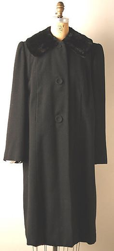 "Black wool coat with velvet collar, by Normal Norell, American, early 1940s. Part of the ""Subway Costume"" with multi-colored sequined dress."
