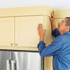 Here's a clever way to add crown to cabinets: Mount the molding on a frame and install it as a single unit. A lot of upper kitchen cabinets ...