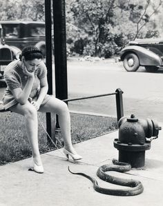 Burlesque dancer, Zorita walking her pet snake, 1937...
