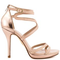 Be envied in the striking Emelyneda by Truth or Dare.  Eye catching rose gold trim is featured at the back, 4 inch heel and 1/2 inch platform.  Contrasting flawlessly is a light blush upper with a sexy adjusting ankle strap.