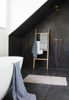 Modern bathroom design with copper faucets and natural textiles.