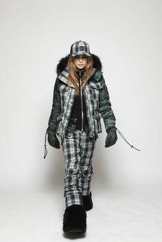 sos-sportswear, skifashion , sportswear, skiing. fashion , saloon pant, fox fur boots , down jacket, zip knit cardigan, checkedfabric, checked cap bluefox www.sos-sportswear.com