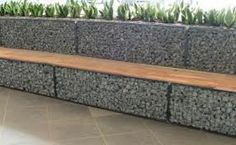 gabian retaining wall seat. Could either do seating like this around perimiter of patio and add benches or just do benches?