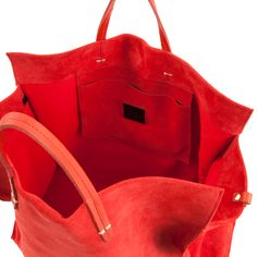 Clare Vivier adds her signature minimal aesthetic to the Red Suede Simple Tote and makes everyday sophistication effortless. Style #TT10003-1716 Dimensions: 15""