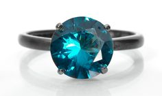 Blue Zircon Solitaire Ring, Silver Tiffany-Set Solitaire with Blue Zircon Gemstone. From Abish Essentials on Etsy.com