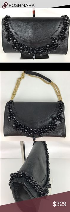 Moschino Boutique Leather Stone Clutch & Crossbody Authentic. New, with Tags.  Gorgeous! Brilliant baubles adorn this flap front Boutique Moschino clutch for bold evening glam. Snap flap closure; lined. Interior slip pocket. Made in Italy. 10.5W x 6.5H x 1.5D. RB752   Thank you for your interest!   PLEASE - NO TRADES / NO LOW BALL OFFERS / NO OFFERS IN COMMENTS - USE THE OFFER LINK :-) Moschino Bags Clutches & Wristlets