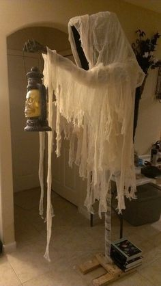 2014 Cloaked Halloween ghost with skull lantern - cheesecloth #2014 #Halloween