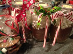 Hot cocoa mix in a mason jar with marshmallows! Accompanied by a bag of homemade Xmas cookies and homemade chocolates!