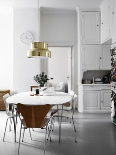 my scandinavian home: A white Swedish kitchen with a brass bumling light.