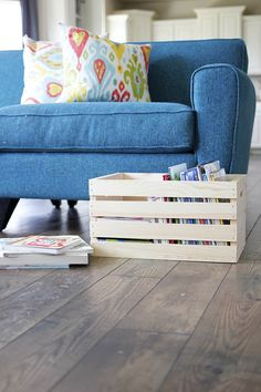 Alix Adams of A Ruffled Life keeps a wooden crate filled with her kids' books in the living room. It's an attractive way to keep the books out of the way... and it encourages reading, too. What a great idea! See her kids room organization ideas on The Home Depot Blog.