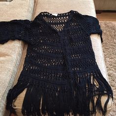 "Totally Boho Sweater 100% acrylic. The brand is re : named and the size is F (what?) the length is 22"" before the fringe and 28"" with the fringe. Across is 29"" perfect condition Re : named  Sweaters"