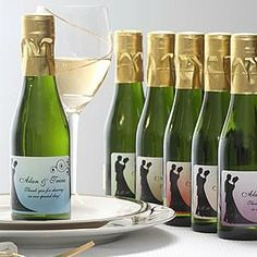 personalized mini wine bottles as wedding favors in out of town guest bags