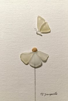 Fluttering 5 x 7 Framed Im a local artist whos love for the beach has grown into creating works of art from sea glass, pebbles, shells, and drift wood. Fluttering, is part of the Cape collection. A ongoing series of works of art made from sea glass, pebbles and driftwood collected