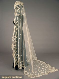 """(i'm assuming this is bridal)  English Honiton lace veil, mid-19th century;   Handmade cream Honiton bobbin lace appliqued on mm cotton net, design motifs of roses and cornucopias with ferns, scattered small leaf sprigs, 74"""" x 74"""""""