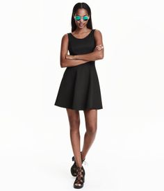 Check this out! Sleeveless dress in jersey with a seam at the waist, deep neckline at the back and circular skirt. - Visit hm.com to see more.