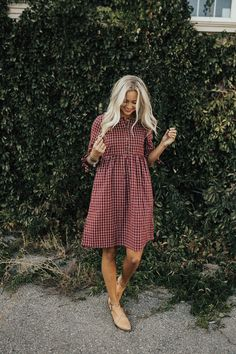 "Burgundy + White Plaid Dress 1/2 Sleeve + Ribbon Tie Cuff Button Up Front Gathered Waist Nursing Friendly Also Available in Black View Size Chart Model is 5'9"" + Wearing a Small"