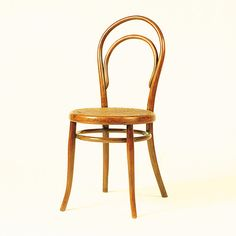 Chair No. 14 | Michael Thonet and Sons | Design: 1859 - 60 Production: 1865 to the present Manufacturer: Gebrüder Thonet, Vienna Size: 92.5 x 42 x 50; seat height 46.5 cms Material: bent beechwood
