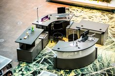Modern TechnoLink Desks & Tables fulfill service needs while complementing the iconic design of the Seattle Public Library.