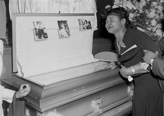 Emmett Till's mother at his funeral. This poor child's violent murder set off a fire storm of protest which resulted in the Civil Rights movement. His brave mother permitted newspapers to print the ravages done to his body so the world may know the horrors of segregation, white supremacy and Jim Crow laws.