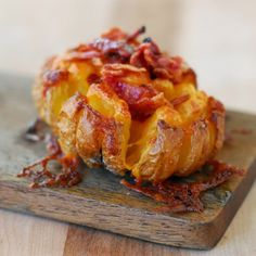 Bloomin' Baked Potato with a salted, crispy skin, toasted cheese and bacon bits! This mouthwatering appetizer is sure to impress!