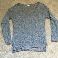 Garage Slouchy Loose Top Light Weight Slouchy Loose Sweater from Garage Clothing. High low Split Hem. Like New  tags taken off and worn once to work that's it. Garage Sweaters V-Necks