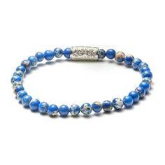 Rebel & Rose Armband Universe Blue 16,5 cm RR-40016-S-16,5. Een mooie natuurstenen armband, model Universe Blue. De armband is vervaardigd uit blauw/creme natuursteen. De schakel is voorzien van het logo van Rebel & Rose en de stenen zijn 4 mm dik. Rebel en Rose armbanden worden vervaardigd uit natuurlijke materialen en onderverdeeld in meerdere collecties zoals 'Stones Only', 'More Balls Than Most', 'Lion Head', 'Absolutely Leather' en de 'Sterling Silver Line'.