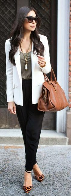 White blazer, black pants and working in style.