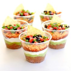 These Individual Seven-Layer Dips are individually portioned dips perfect for parties. No double dipping here! the-girl-who-ate-everything.com