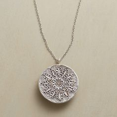 LOTUS NECKLACE--Hilltribe artisans in northern Thailand stamp an exuberant lotus into 99% silver. Disk slides along sterling silver chain