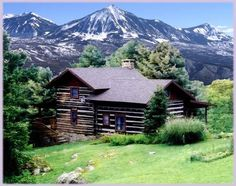 Log cabin in the mountains...Awesome! Now that's my dream home