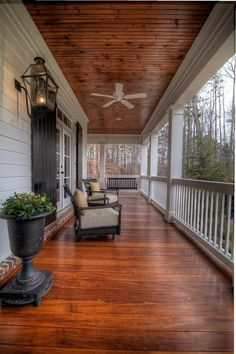beautiful porch with rich wood floor and ceiling