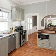 gray kitchen peninsula with butcher block countertop kitchen