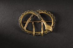 Oval buckle with snake head in metal, ca 1850 | In the Swan's Shadow